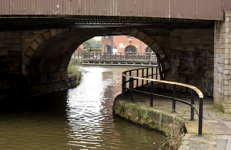 The view under a dark bridge near Wigan Pier on the Leeds Liverpool canal