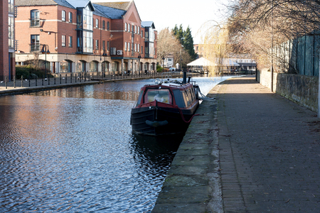 A canal barge moored up on the Leeds Liverpool canal in Wigan