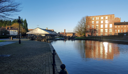 The view over the Leeds Liverpool canal to the dry dock in Wigan Stock Photo