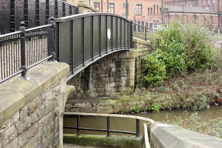 A small metal bridge over the canal in the centre of Wigan Stock Photo