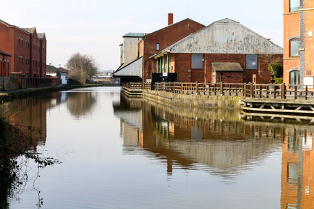 The view along the Leeds Liverpool canal towards the buildings opposite Wigan Pier