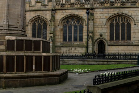 The stone facade of the parish church and cenotaph in Wigan