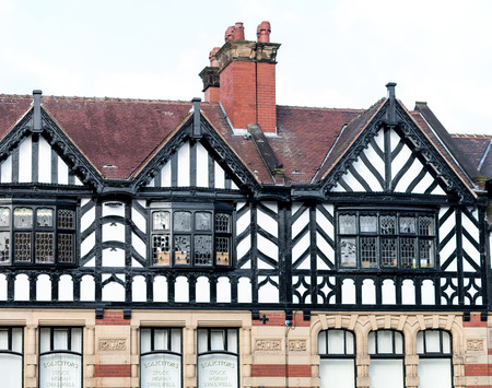 A black and white tudor fronted building Stock Photo