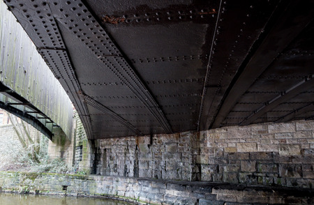 The black metal rivets of the bridge over the canal Stock Photo