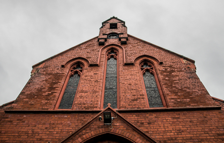 The red brick facade of the local church