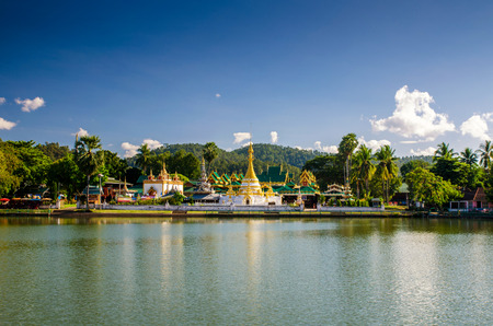 grand sons: jong kum and jong klang temple in front of pool in meahongson , thailand