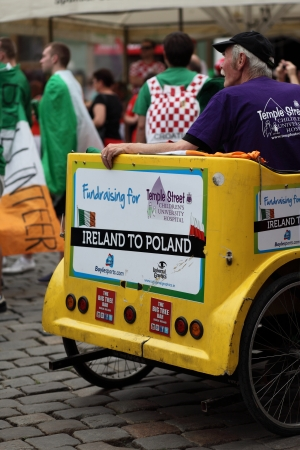 fundraiser: Poznan, Poland, June 10, 2012 - UEFA Euro 2012 An Irish Fundraiser sitting in his cart