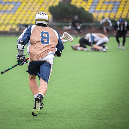 Lacrosse player Standard-Bild