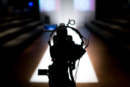 camera operator: Fashion Show Stage Stock Photo