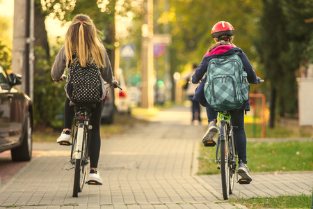 backpack: Two Girls Riding a Bicycle