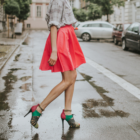 fashion style: Young fashionable girl walking on the street