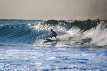 Pro Surfer riding the waves Stock Photo