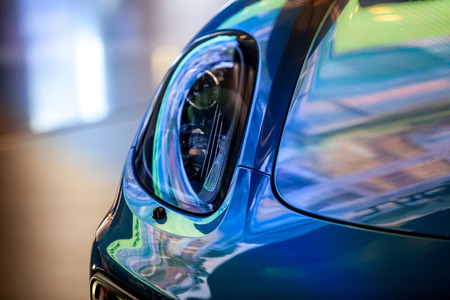 Close Up on a beautiful modern supercar with dramatic lighting