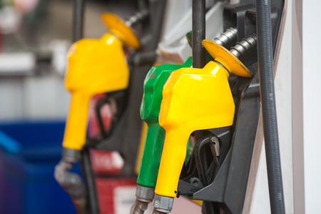 Petrol pump station nozzles at the gas station in a service Stock Photo
