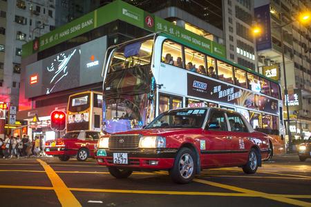 argyle: Mong Kok, Kowloon, Hong Kong - OCTOBER 14, 2017: Public transportation on the Argyle Street and Nathan Road crossing in Mong Kok, Kowloon, Hong Kong on October 14, 2017.