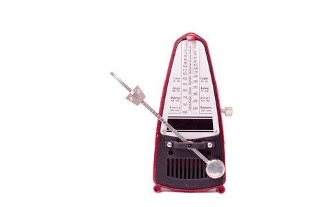 A metronome against a white background. The swinging arm is angled away to reveal the sliding scale of beats per minute Stock Photo - 8126339