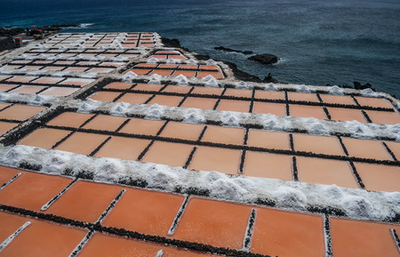 Fuencaliente saltworks, with Atlantic ocean background, La Palma, Canary islands, Spain Stock Photo