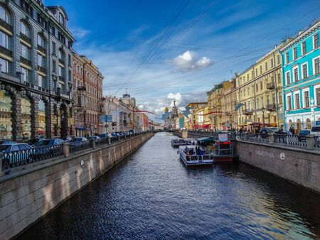Saint Petersburg, Russia; May 11 2017: one of the many navigable canals of St. Petersburg with blue sky, with shade and sunlight