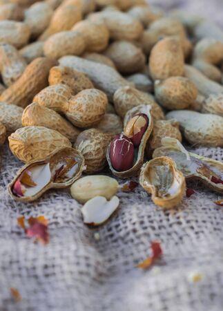 Peanuts (Arachis hypogaea) on sack surface
