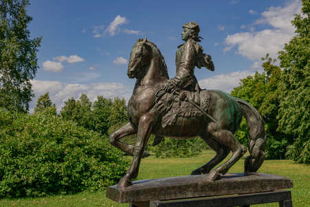 Moscow / Russia; July 05 2019: Elizabeth Petrovna horsewoman sculpture, (Elizabeth of Russia), with green trees background Redactioneel