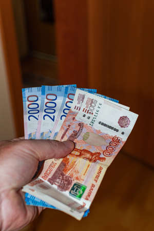 Five and two thousand rubles banknotes, on the left hand Reklamní fotografie