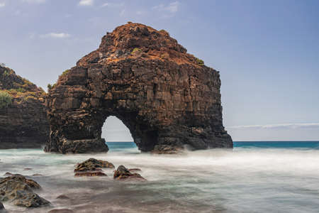 Volcanic rock arch, Los Roques beach, long exposure, Los Realejos, Tenerife, Canary islands