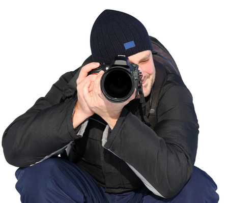 Man taking pictures with digital camera photo