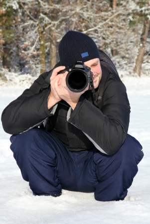 Photographer in the winter landscape photo