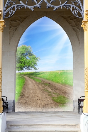 Opened door to early morning in green garden - conceptual image - environmental business metaphor - success concept photo