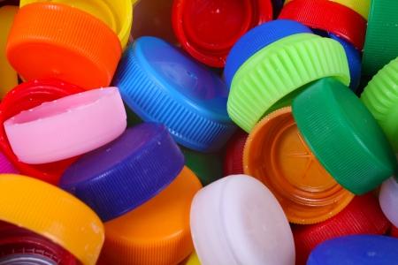 Kleur plastic doppen achtergrond Stockfoto
