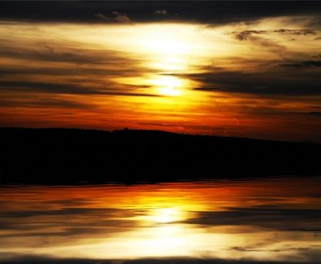 rushy: Beautiful sunset over river Stock Photo