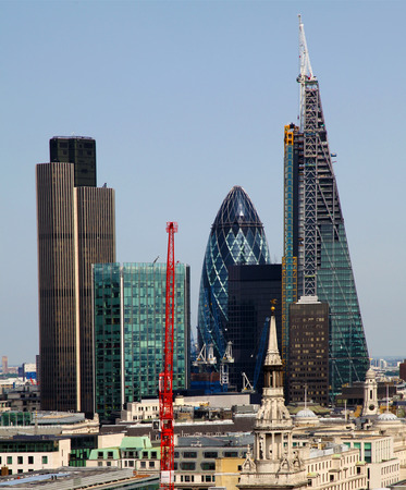 willis: City of London one of the leading centres of global finance This view includes Tower 42 Gherkin,Willis Building,  Stock Exchange Tower and Lloyd s of London and  Canary Wharf at the background  Editorial
