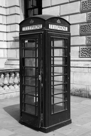 Traditional telephone booth in London, black and white photo photo