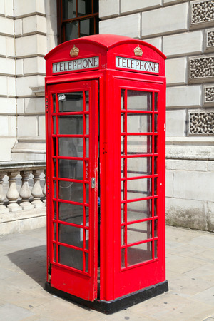 Traditional red telephone booth in London photo