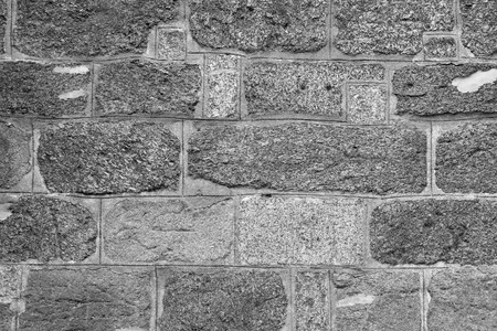 stone wall: Black and white background of stone wall texture Stock Photo