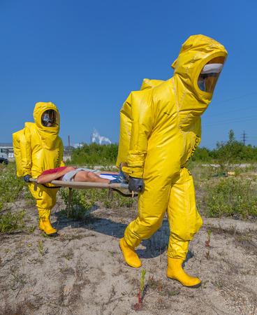 Mans in protective hazmat suit, blue sky photo