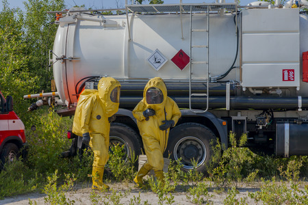 Mans with briefcase in protective hazmat suit photo