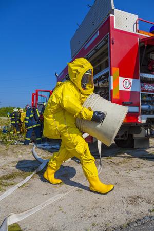 bio hazard: Man with briefcase in protective hazmat suit