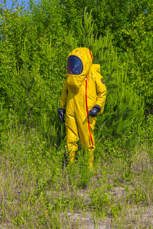 Man with briefcase in protective hazmat suit photo