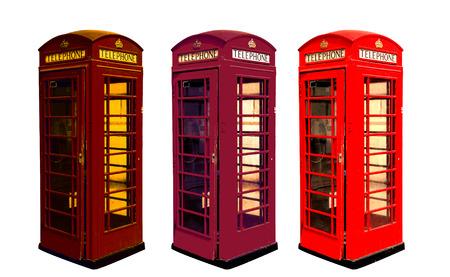 Classic British color phone booths in London UK, isolated on white photo