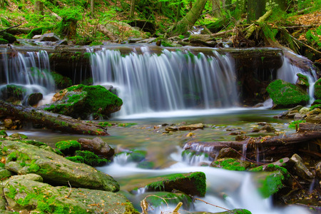 flowing river:  Waterfall in the national park Sumava-Czech Republic Stock Photo