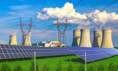 environmental protection: Solar energy panels before a nuclear power plant Dukovany Stock Photo