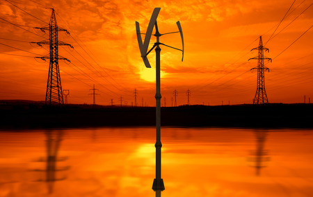 electric power station: Power lines, small wind turbine at sunset Stock Photo