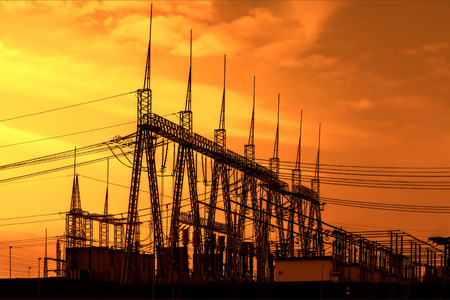 electrical tower: High voltage power transformer substation, sunset