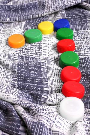 re design: Color plastic caps background