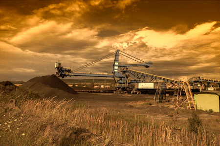 coal mine: A giant wheel excavator in brown coal mine at sunset