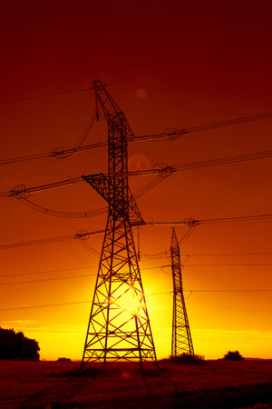 electrical equipment: Power line in the sunset Stock Photo
