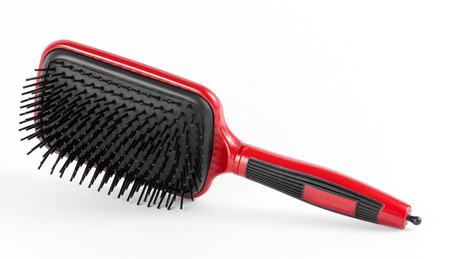 perming: Red comb the hair on a white background