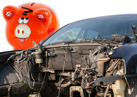 car wreck: Car wreck and orange piggy bank style money box Stock Photo