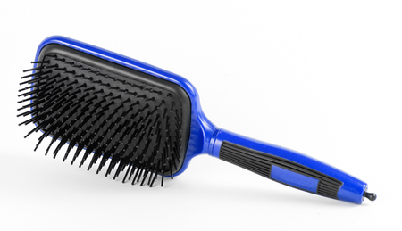 perming: Blue comb the hair on a white background